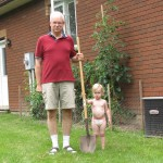 Dad has a sturdy shovel of his own, and is passing on his wisdom to the next generation!