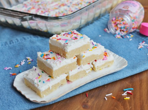 Perfect Sugar Cookie Bars: soft, chewy, a healthy layer of vanilla icing...these are one of the most popular treats I bake!
